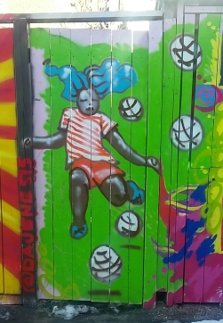 Mural - girl with soccer balls